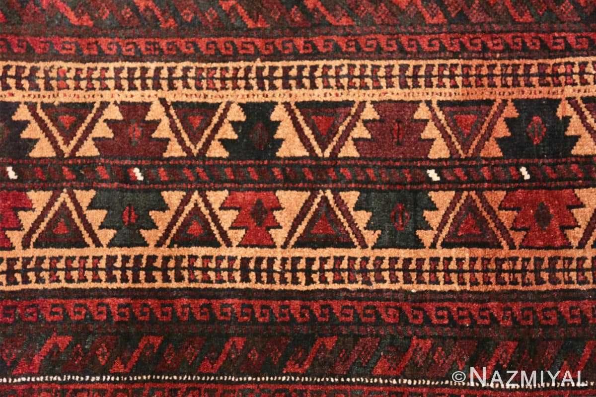 Close-up Small scatter size Antique Persian Baluch rug 2529 by Nazmiyal