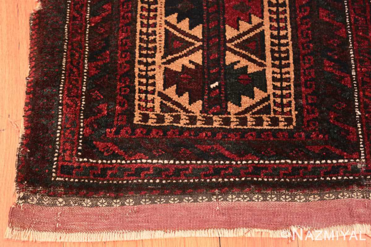 Corner Small scatter size Antique Persian Baluch rug 2529 by Nazmiyal