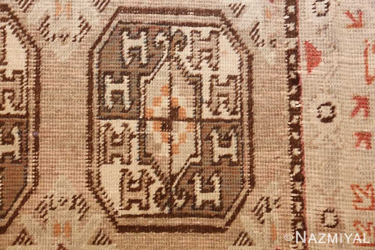 antique long and narrow oriental khotan rug 41761 closeup Nazmiyal