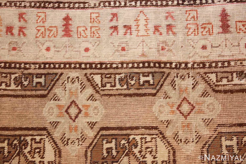 antique long and narrow oriental khotan rug 41761 red lines Nazmiyal