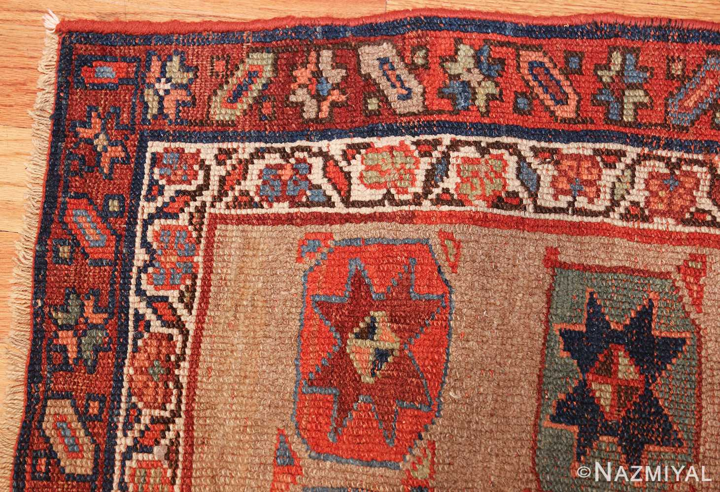 small scatter size tribal antique persian kurdish rug 44932 corner Nazmiyal