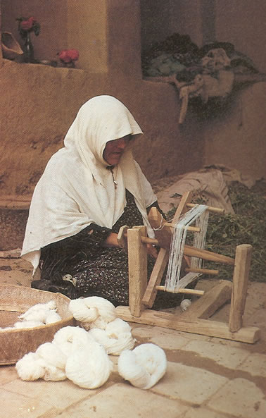 Spinning Wool for weaving a rug by Nazmiyal