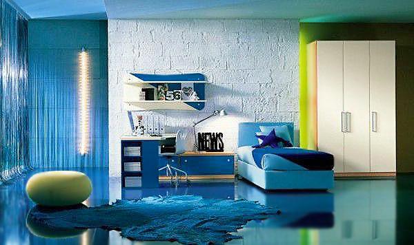 Vibrant Blue Colored Interior Design Of a Modern Kids Bedroom - Nazmiyal