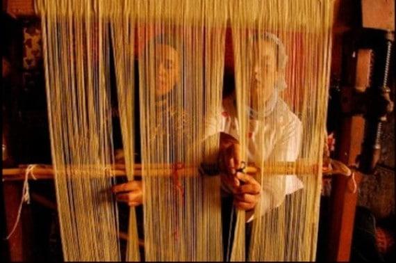Moroccan Women Weaving a Berber Rug by Nazmiyal