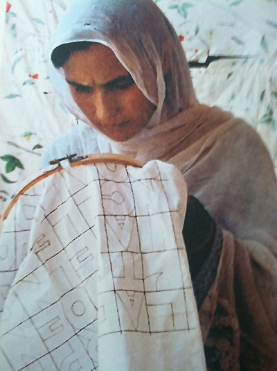 Afghan Woman Weaving An Embroidery