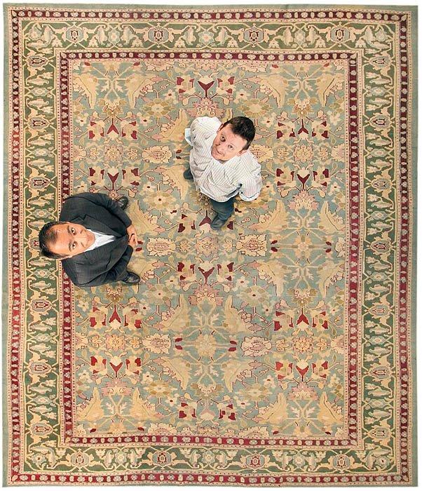 Jason Nazmiyal And Omri Schwartz On Antique Rug by Nazmiyal
