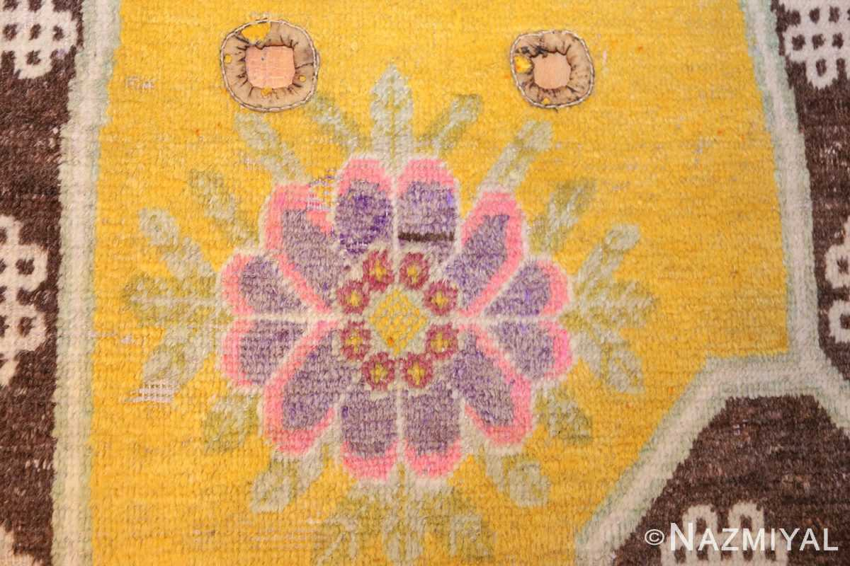 antique saffron yellow chinese saddle rug 47784 flower Nazmiyal