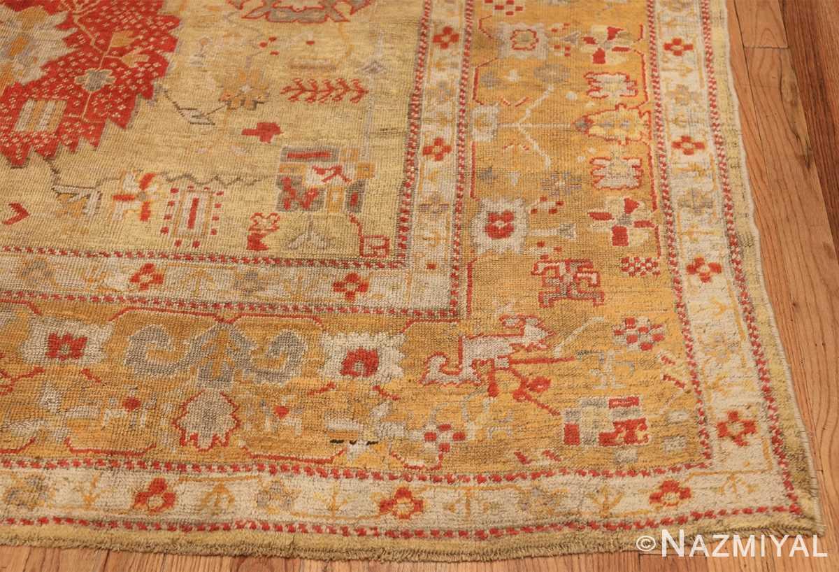 Tribal and Primitive Decorative Antique Turkish Oushak Rug 47260 Side Corner Nazmiyal