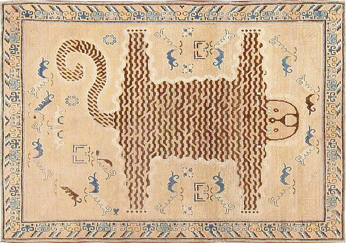 Antique Animal Pelt Design Motif Khotan Rug - Nazmiyal