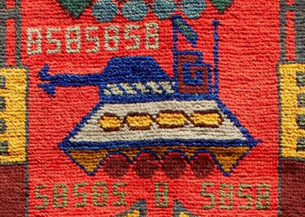 Image of a tank woven into a modern Afghan War Rug - by Nazmiyal NYC