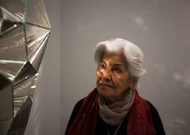 Artist Monir Farmanfarmaian inspects the installation of one of her mirrored artworks at the Guggenhim Museum in NYC.
