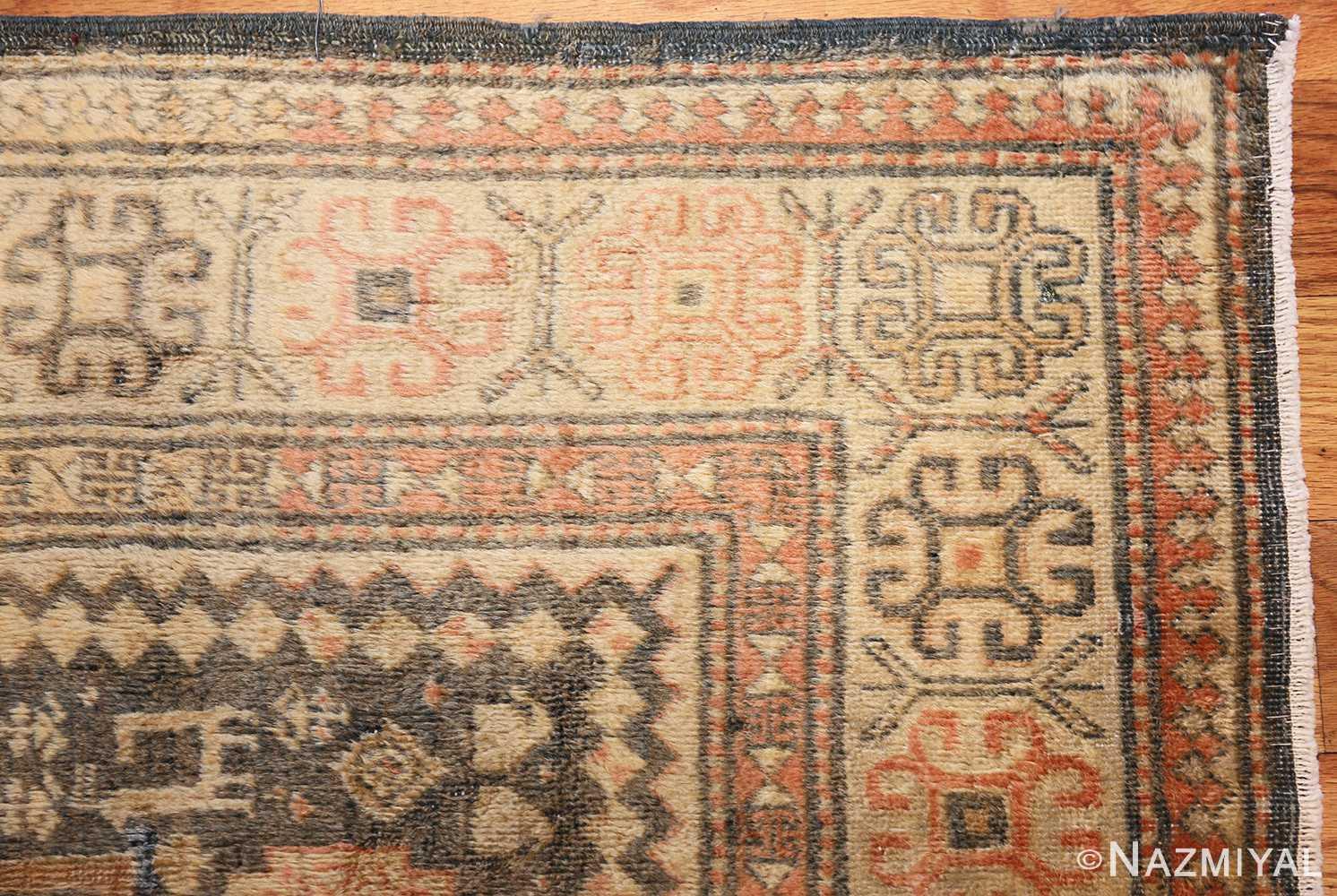 antique caucasian rug with tribal motifs 48092 corner Nazmiyal