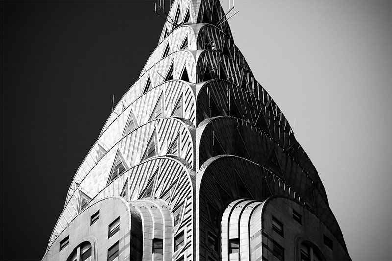 The Chrysler Building in New York, with its curving and angular lines, is a great example of Art Deco architecture, on Nazmiyal blog.