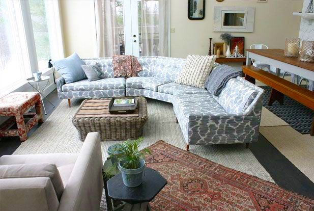 Living Room Interior With Layered Oriental Rugs by Nazmiyal