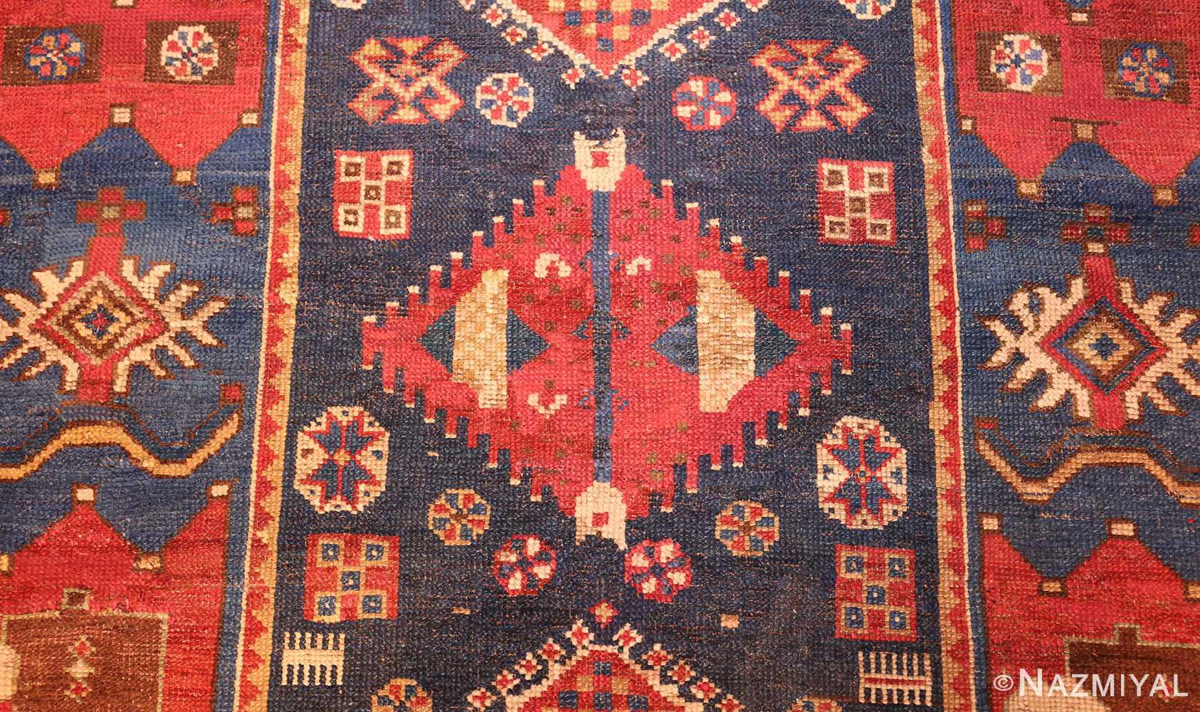 small antique caucasian kazak rug 48719 center Nazmiyal