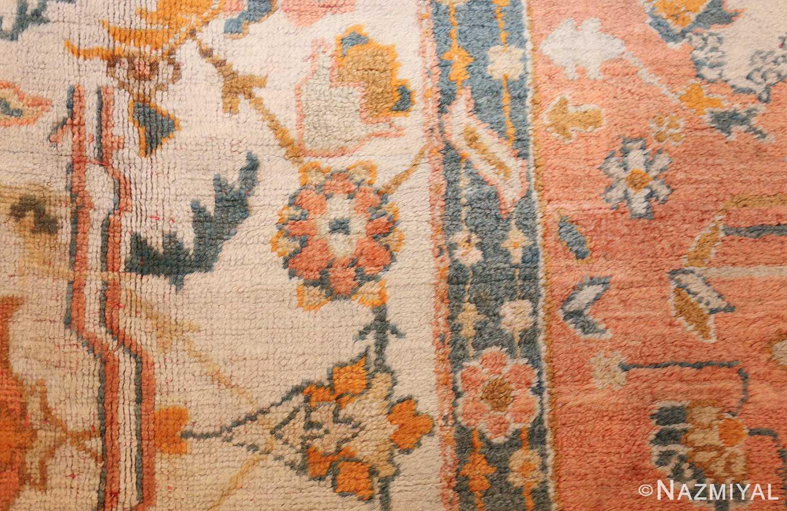 large ivory background turkish antique oushak rug 50666 closeup Nazmiyal