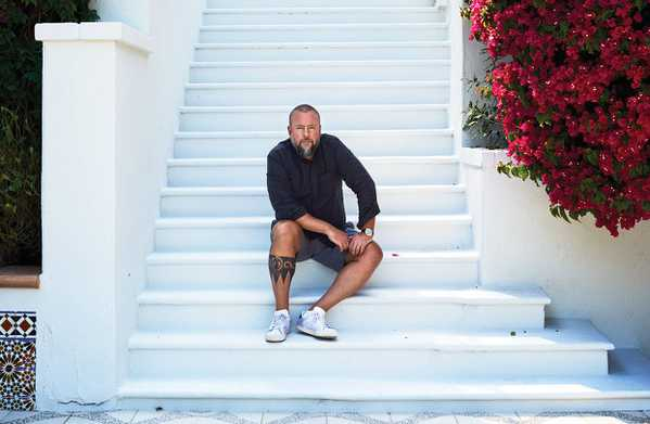 Shane Smith sitting on steps of new Santa Monica Villa