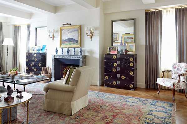 Jayne Design Studios decorates a beautiful apartment with Isfahan rugs and collectibles