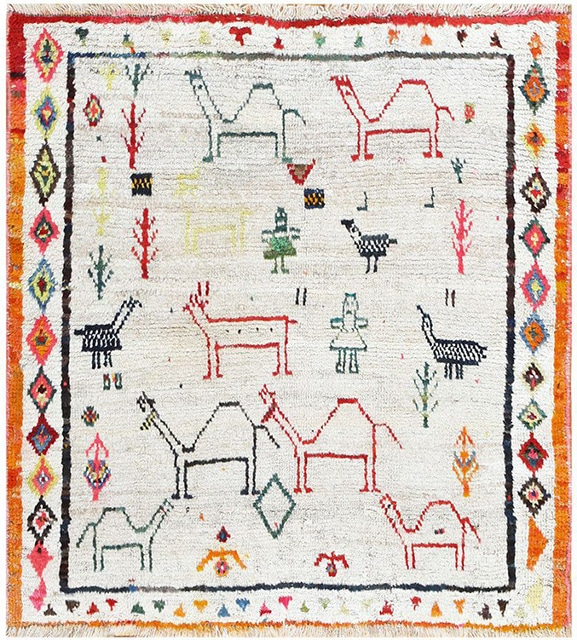A charming vintage Gabbeh with colorful patterns of animals and trees.