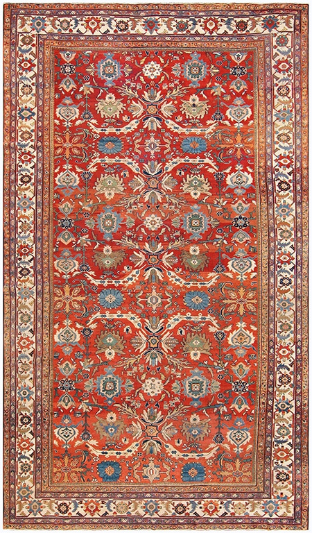 An eclectic mix of colors in this Sultanabad rug make it one happy antique rug.