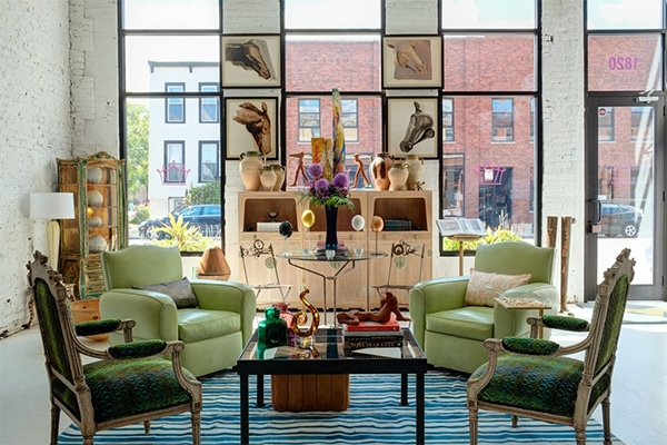 A Mid Century Vintage Rug in Room shows beautiful bold colors and eclectic furniture.