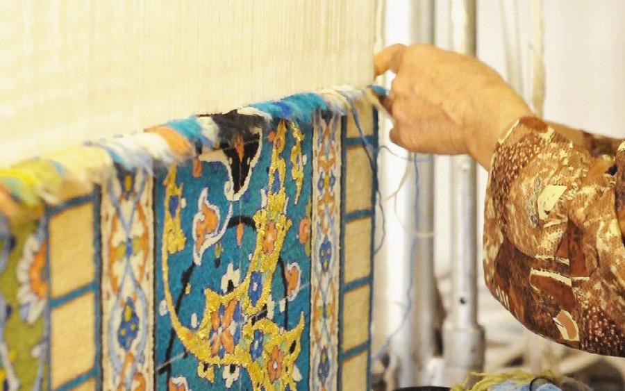Persian City Rug Weaver Weaving a Fine Carpet Nazmiyal