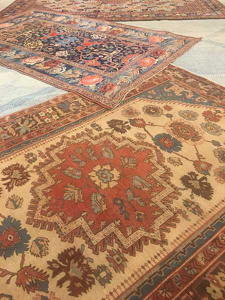 Layering Rugs: Small Antique Persians matched with a large blue Moroccan, Nazmiyal