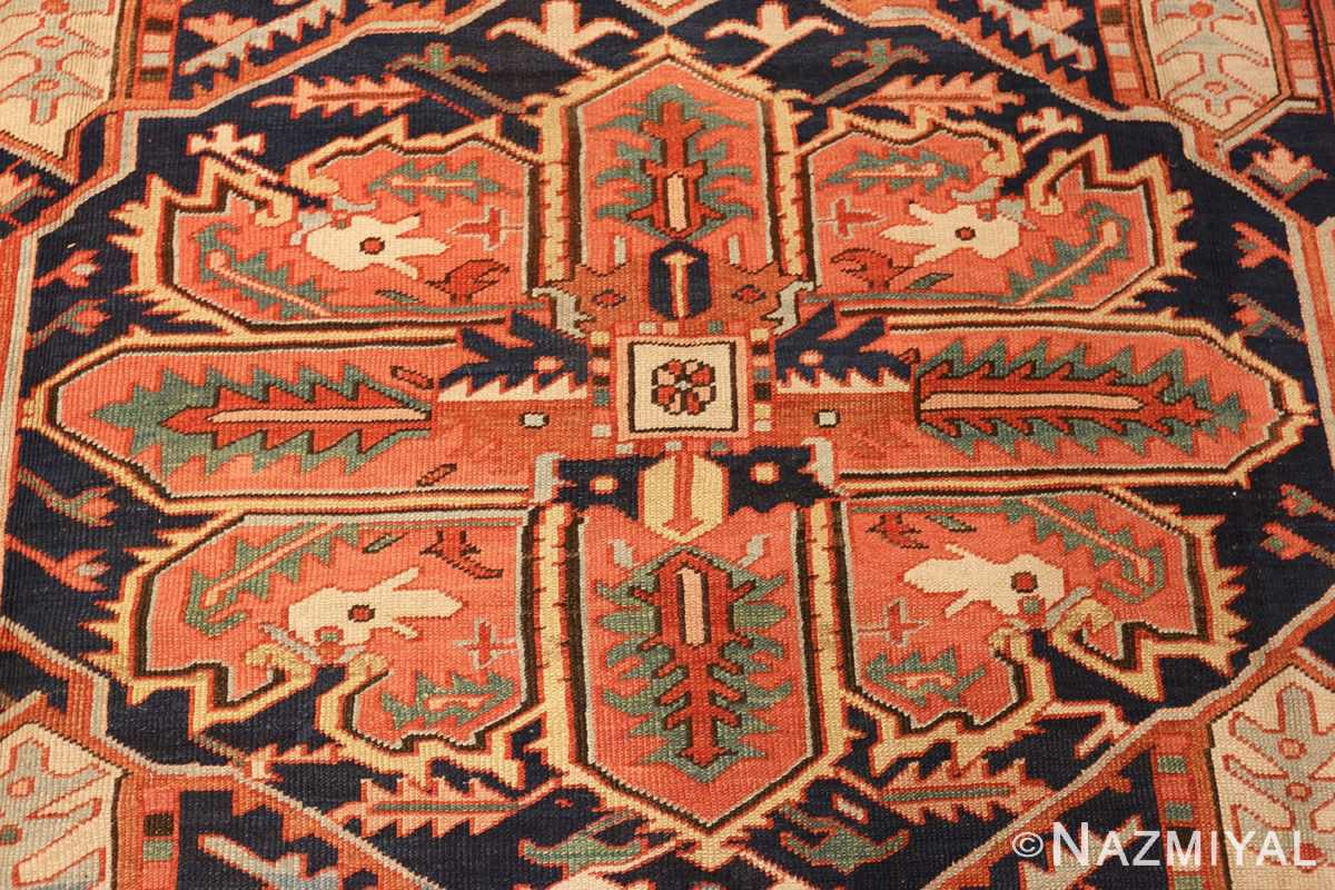 large red background antique serapi persian rug 49325 center Nazmiyal