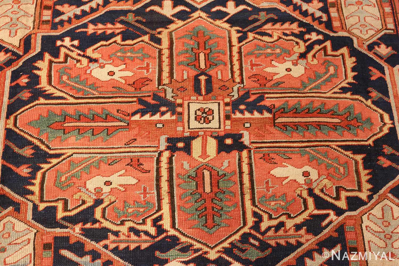 large red background antique serapi persian rug 49325 center Nazmiyal