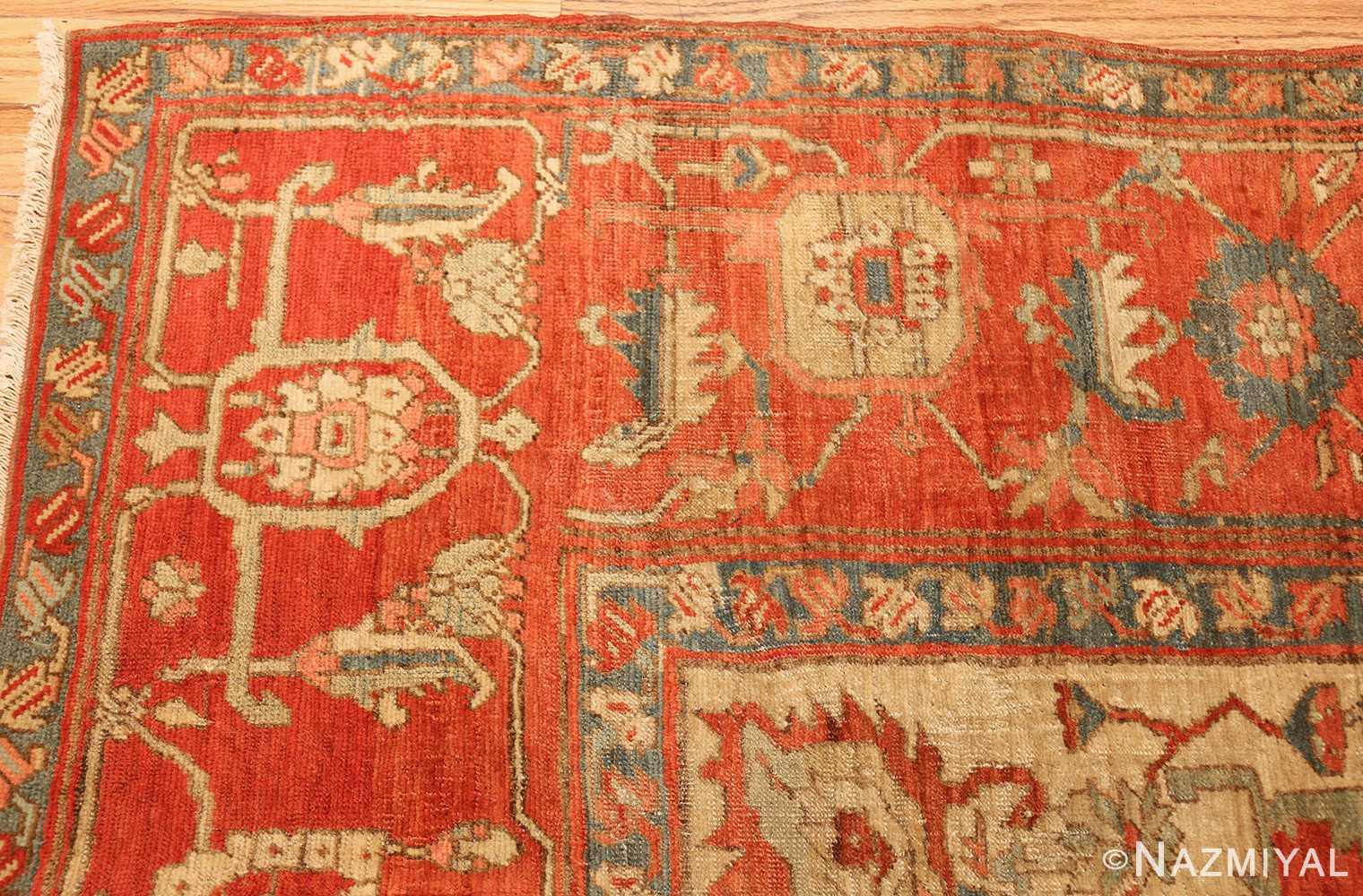 red background antique serapi persian rug 49351 corner Nazmiyal