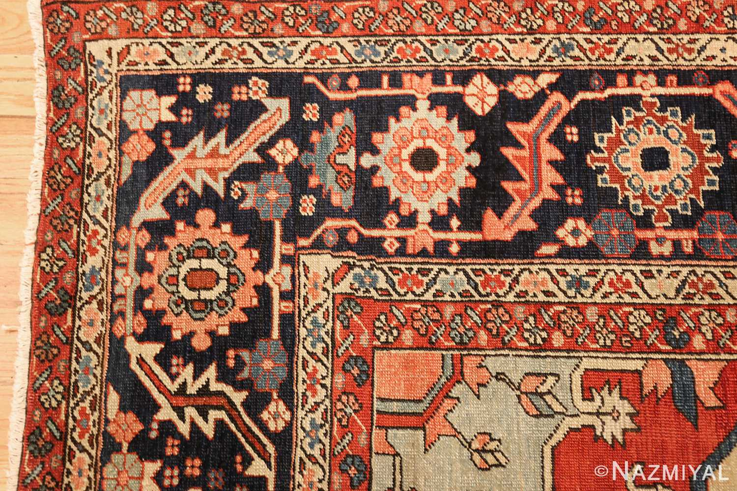 red background antique serapi persian rug 49358 corner Nazmiyal