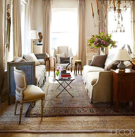 Layered Persian Rugs Over Sisal - Nazmiyal