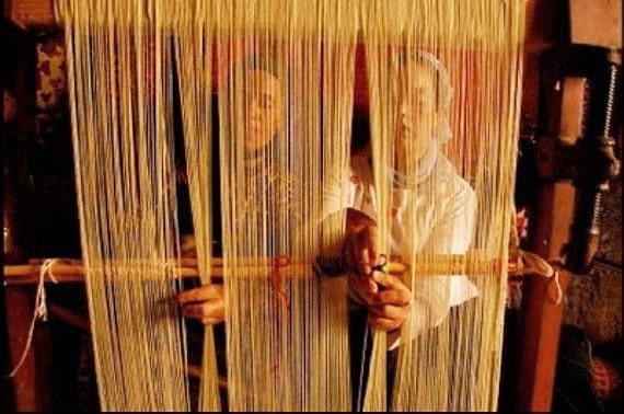 Moroccan Rug Weavers Handmaking Rugs by Nazmiyal