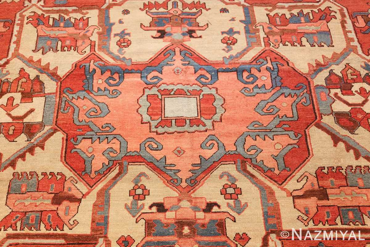 antique red background serapi persian rug 48240 center Nazmiyal
