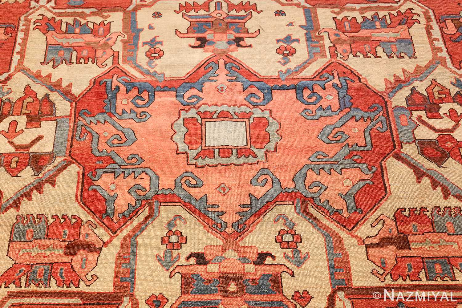antique red background serapi persian rug 48240 center Nazmiyal