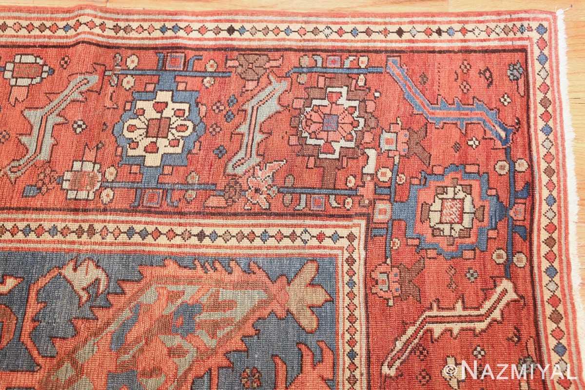 antique red background serapi persian rug 48240 corner Nazmiyal