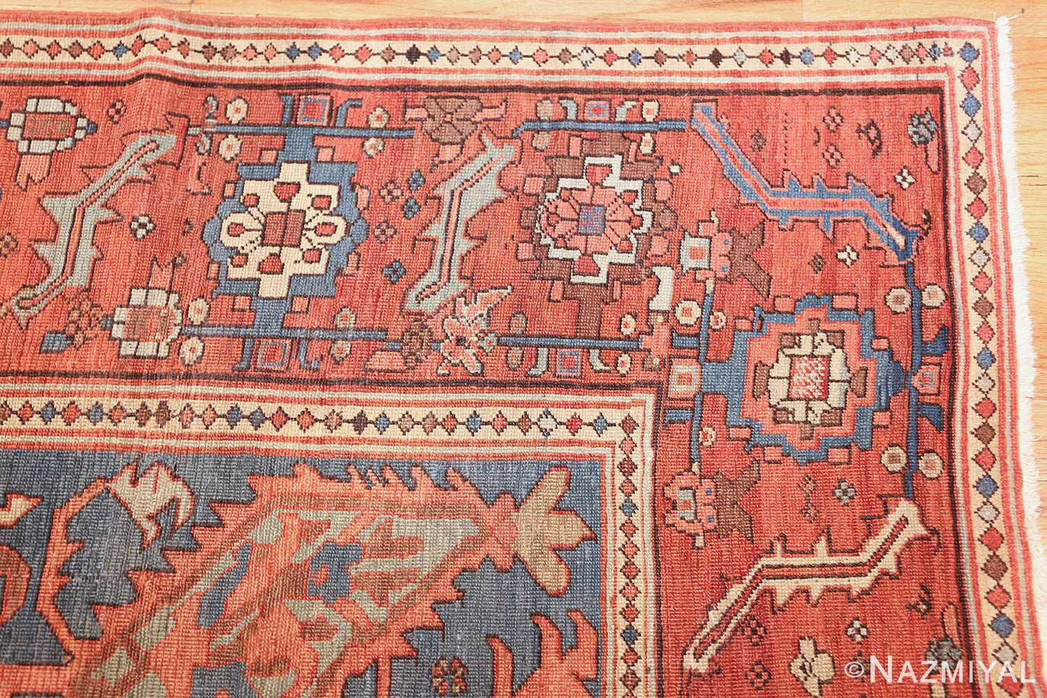 antique red background serapi persian rug 48240 corner Nazmiyal