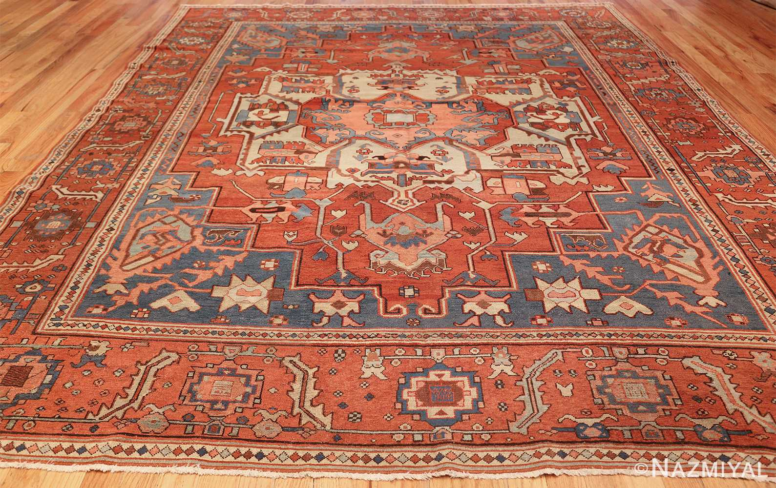 antique red background serapi persian rug 48240 whole Nazmiyal