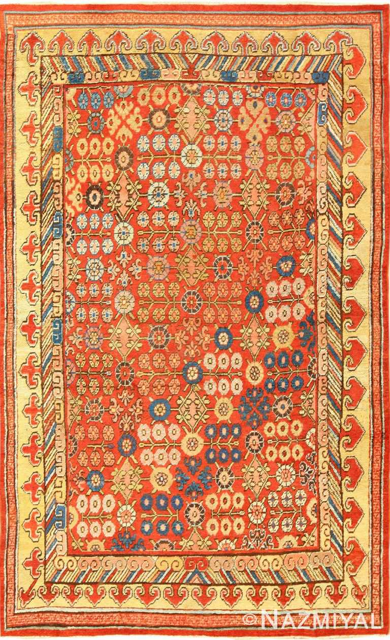 small antique red background khotan rug 49033 Nazmiyal