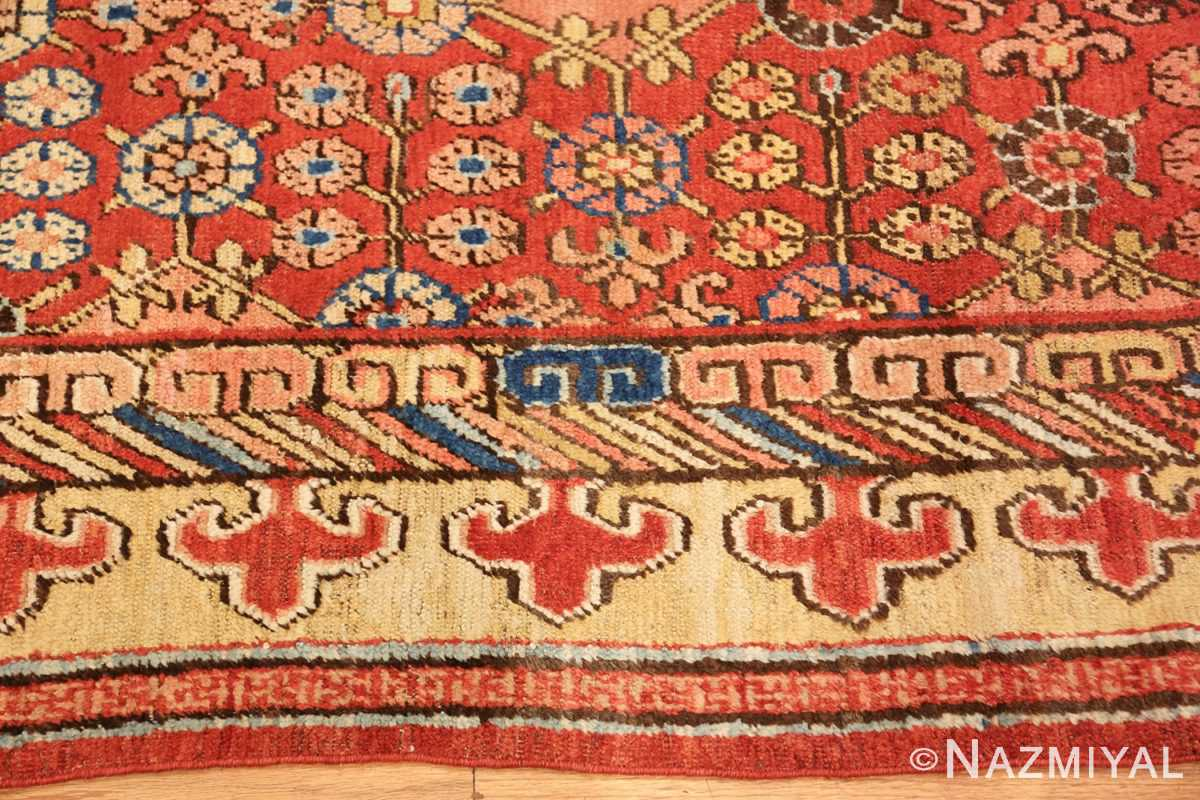 small antique red background khotan rug 49033 border Nazmiyal