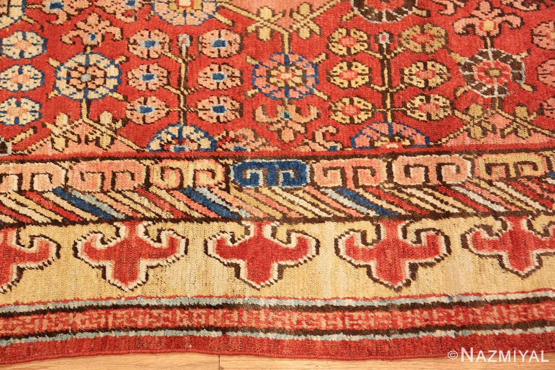 small antique red background khotan rug 49033 border Nazmiyal