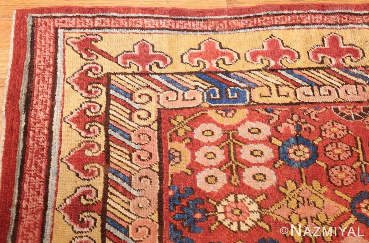 small antique red background khotan rug 49033 corner Nazmiyal