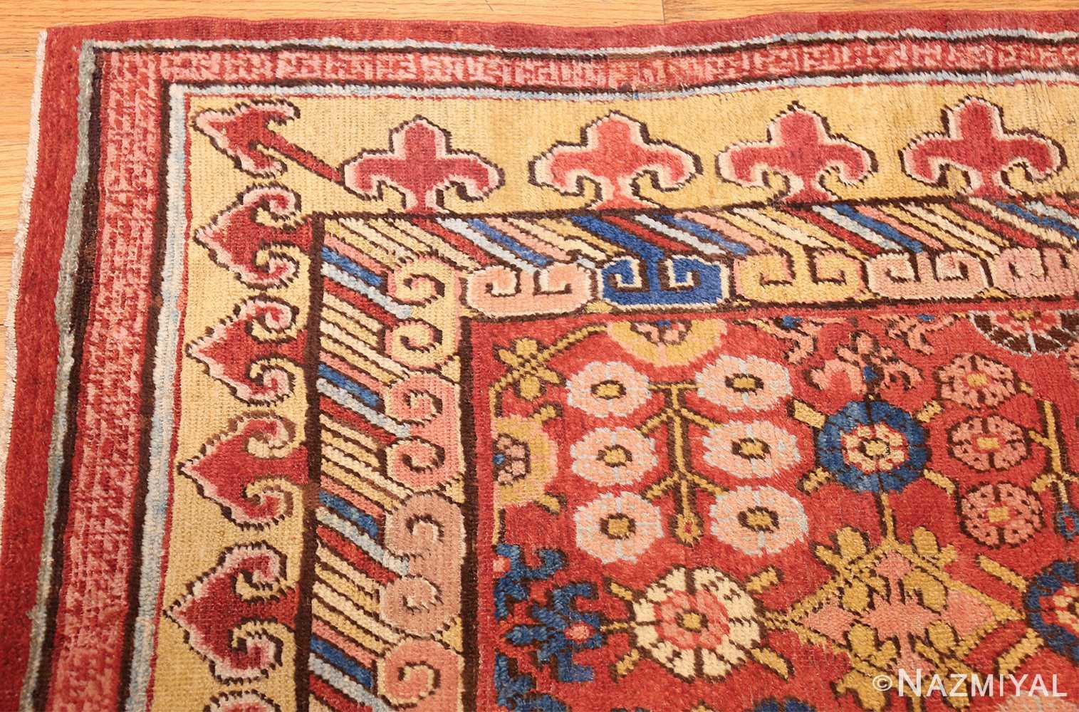 small antique red background khotan rug 49033 corner Nazmiyal
