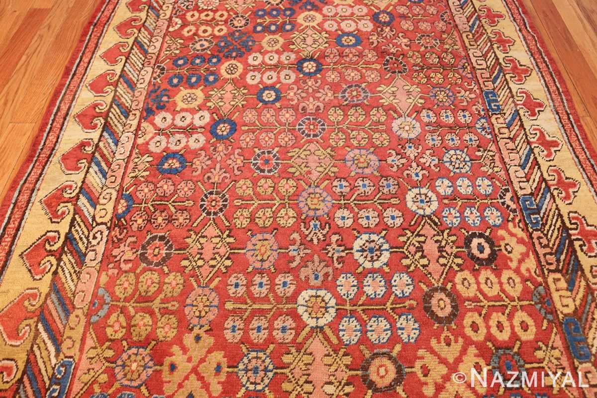 small antique red background khotan rug 49033 field Nazmiyal