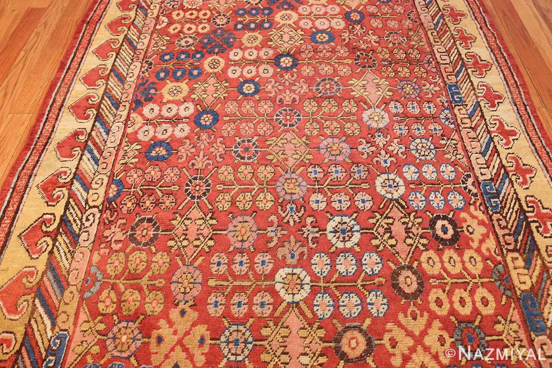 small antique red background khotan rug 49033 field Nazmiyal