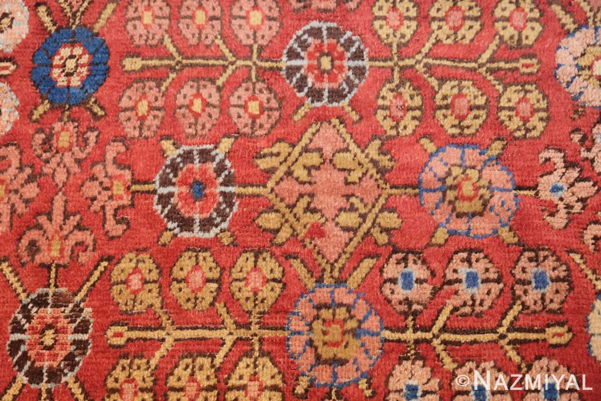 small antique red background khotan rug 49033 flowers Nazmiyal