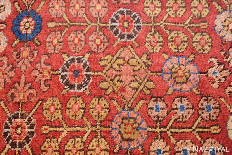 small antique red background khotan rug 49033 flowers Nazmiyal