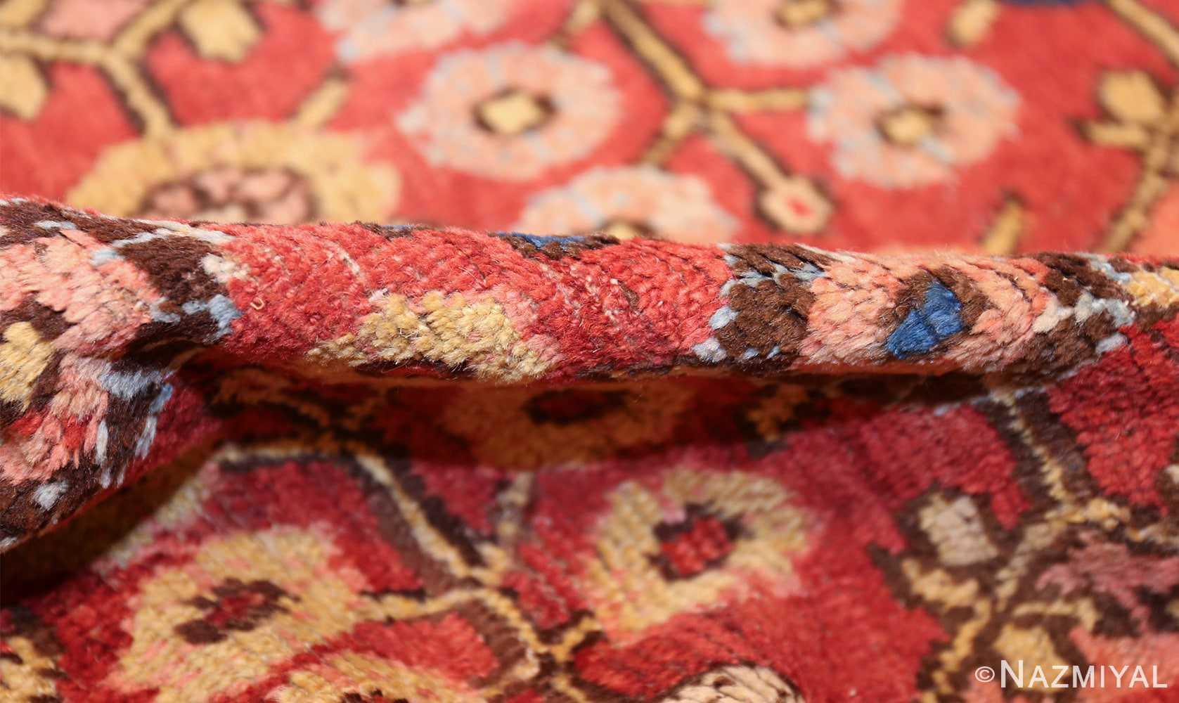 small antique red background khotan rug 49033 pile Nazmiyal