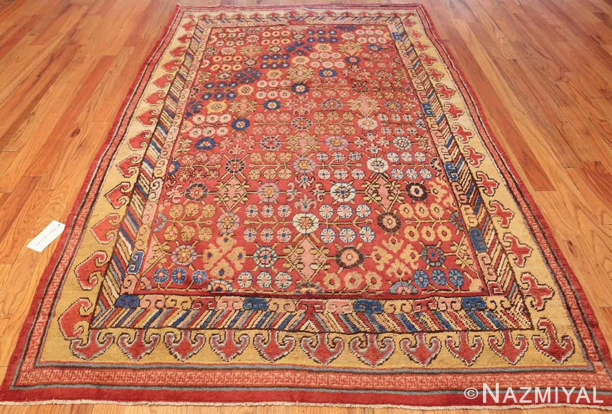 small antique red background khotan rug 49033 whole Nazmiyal