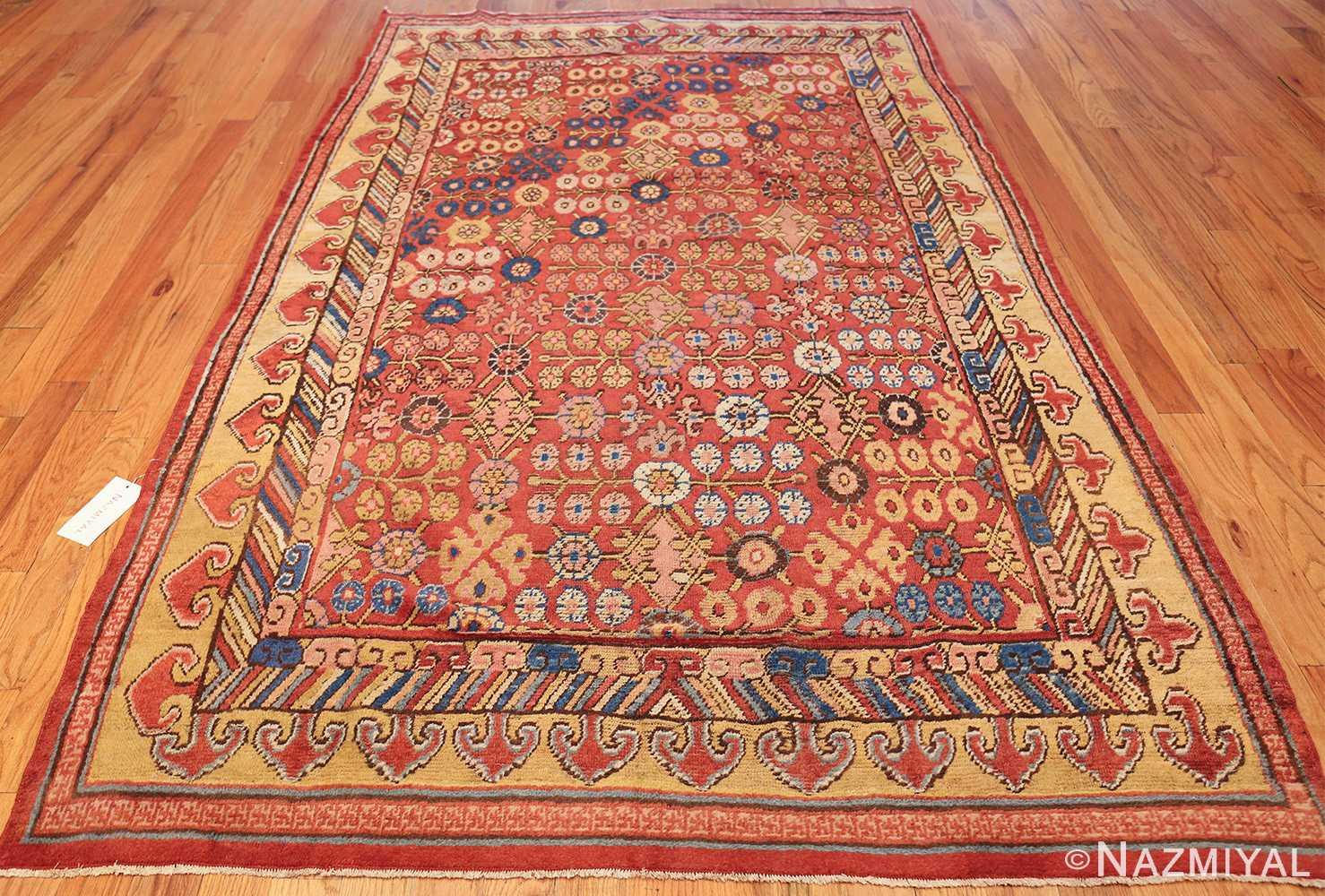small antique red background khotan rug 49033 whole Nazmiyal